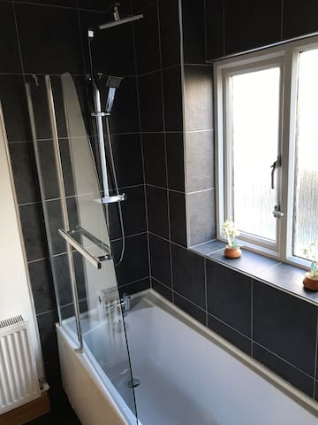 First floor shared bathroom. Bath/shower in a beautifully designed clean and modern space.