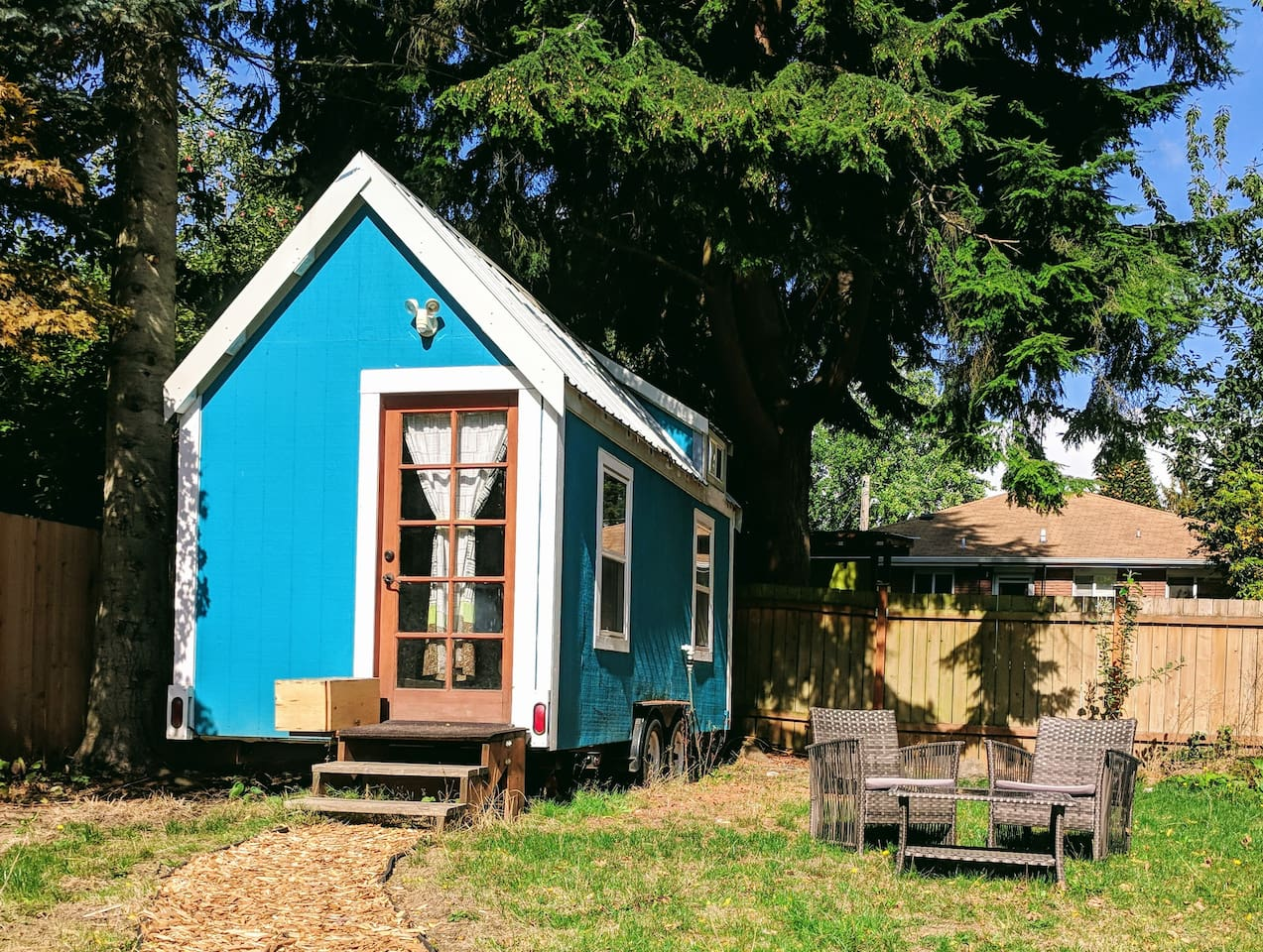 The tiny house is nestled into the backyard of an 8,000 square foot lot. It's a quiet retreat from the city's hustle and bustle!
