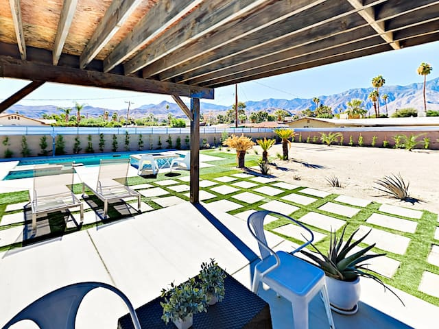 The converted carport serves as an outdoor living room complete with shade curtains and views of the pool.