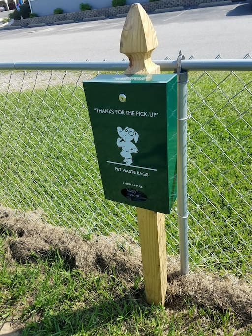 Pet waste dispenser in the back yard. We ask our guests kindly pick up their pet's waste and throw it in the garbage bin. Thank you for respecting our space!