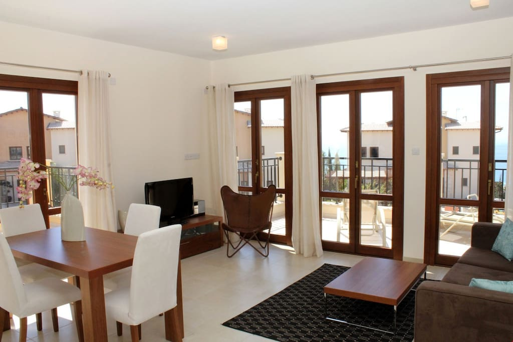 Relax in the spacious living area and catch a show on TV. Photos are representative.
