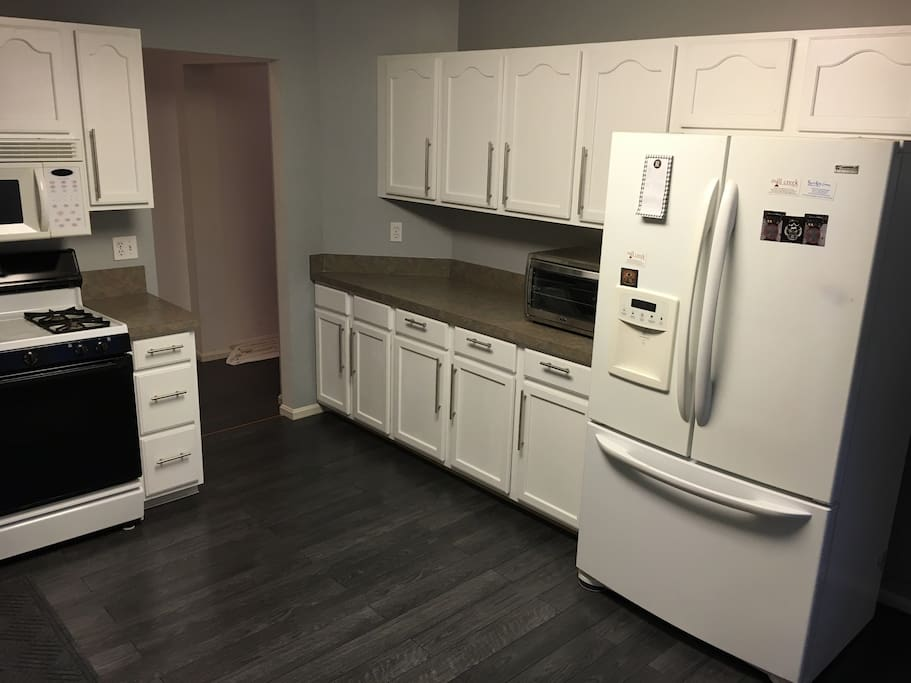 Kitchen with brand new modern floor and color scheme.