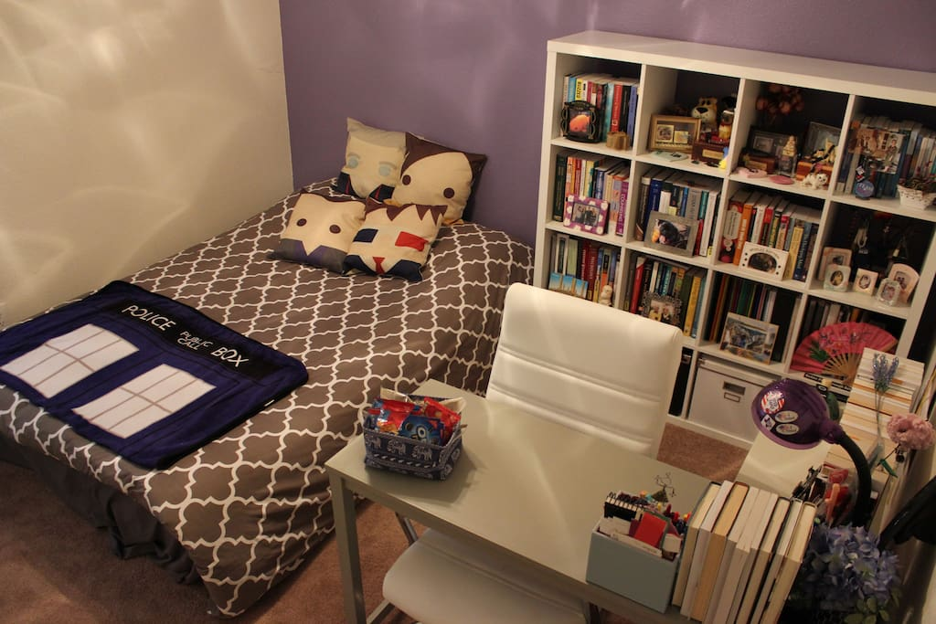 This is where you get to stay. Fancy aerial view (me standing on a step-stool) from the doorway of the guest room/office. Lots of books and Doctor Who pillows! If you're not a Whovian, I won't judge you. (Too much.)