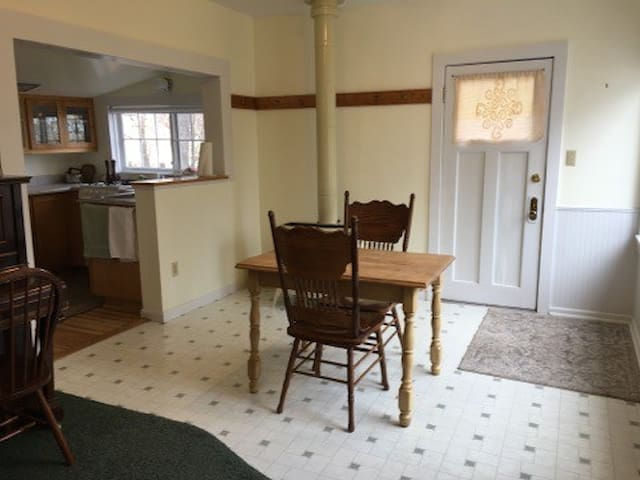 Dining Room & Kitchen with Entrance Door Leading to Deck