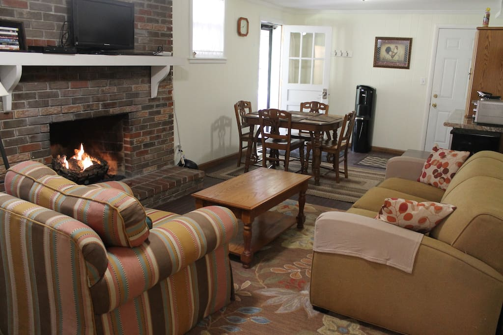 Even warmer in the winter, when the gas log fireplace will be ready to toast your toes! And note the oak table and chairs in the background. Great place for a little breakfast when it's too chilly for the patio. Noted?