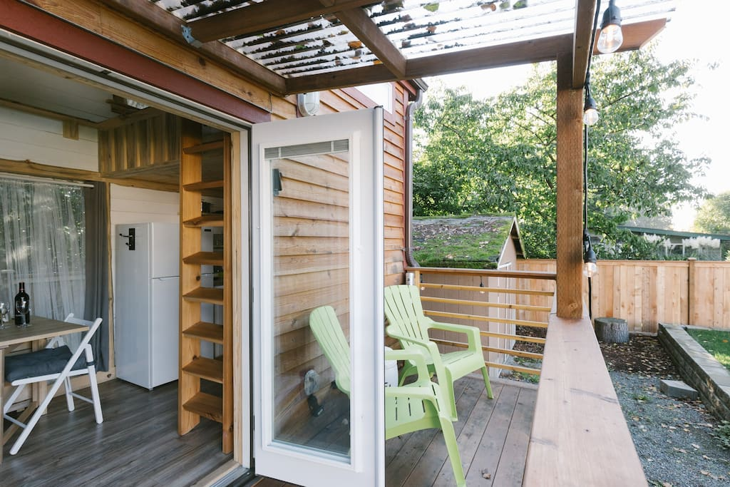 Cedar deck will extend your tiny experience outside