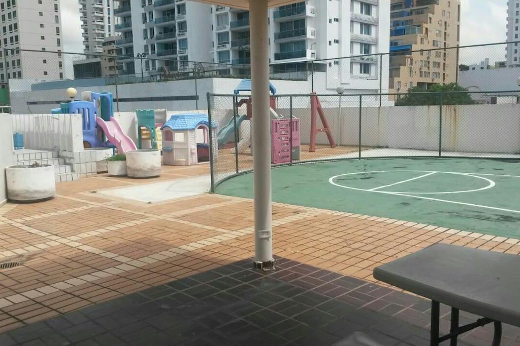 Kids playground and basketball hoop