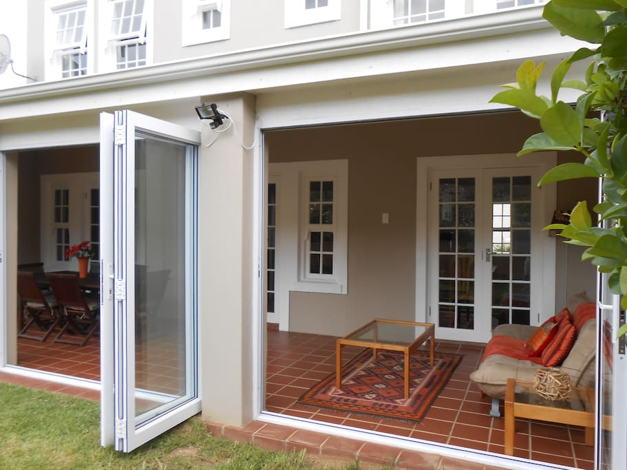 Enclosed veranda with fold back sliding doors leading onto private garden.