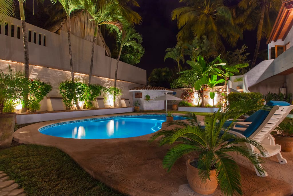 Our tropically landscaped and entirely gated in yard provides complete seclusion and security to enjoy amazing Sayulita.  View of the pool from the master bedroom, French door walkout.