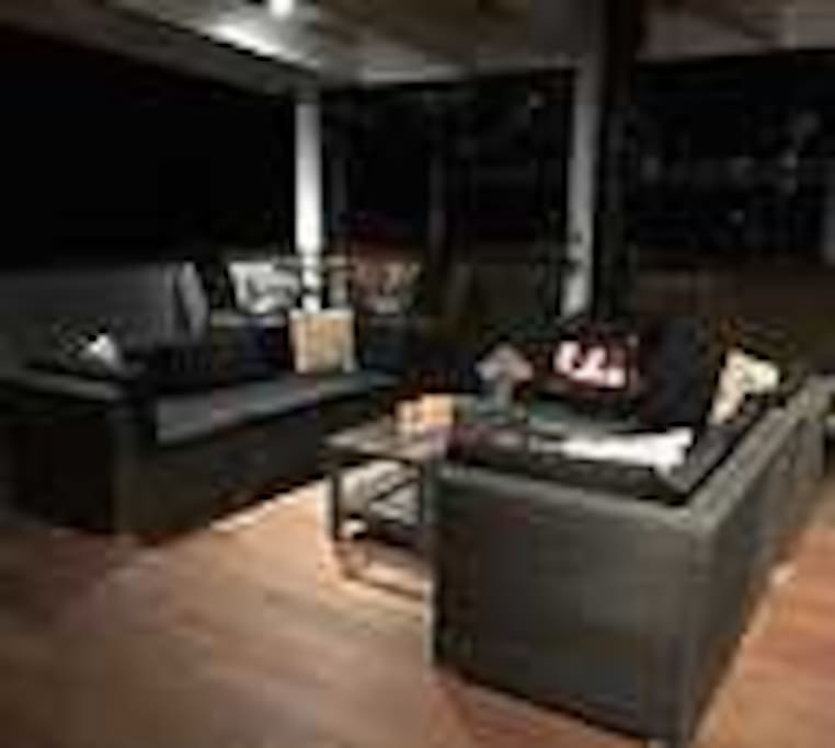 Undercover Outdoor Entertainment area with wood heater & outdoor dining
