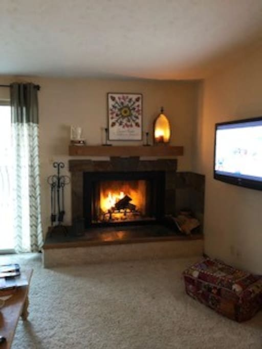 Cozy wood burning fireplace and since photo we have new wood floors