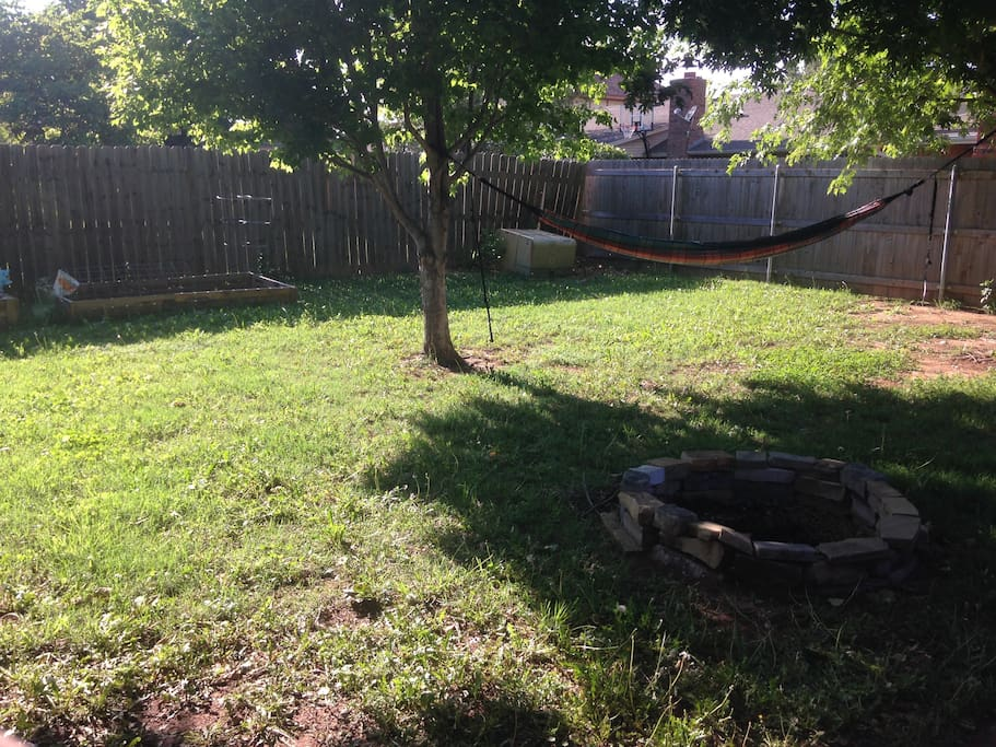 Here is the backyard complete with hammock, garden with fresh veggies, and a fire pit.