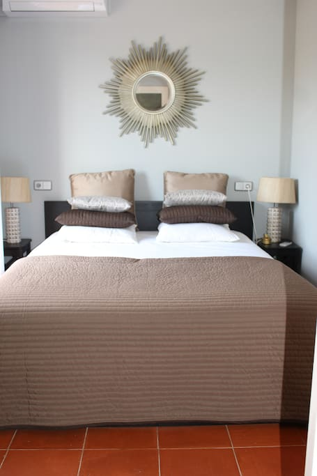 Master bedroom with a small terrace and its own bathroom. The bedroom has also TV