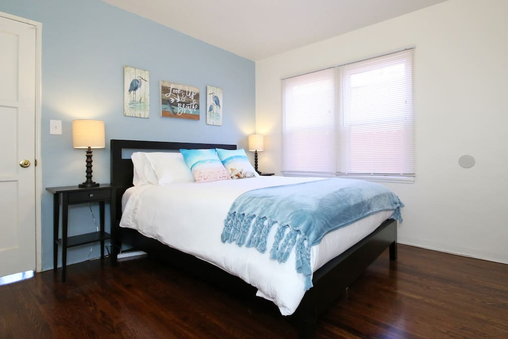 """Bedroom 1: Queen Bed - """"Lovely stay! Very clean and organized with everything we could need. Beds were great! For a small place, comfortable and cozy."""" - Tricia, guest"""