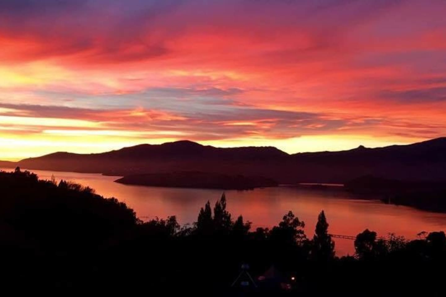 Amazing sunrise across the harbour from the bedroom balcony.