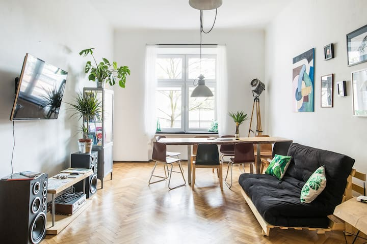 Living room with a sofa bed and a large oak table for 8 people