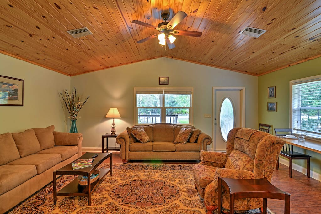 The interior features comfortable furniture and vaulted wooden ceilings.