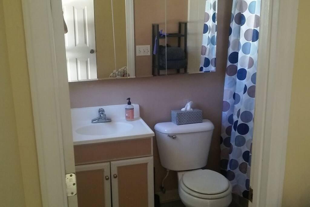 Full bathroom with shower & tub.