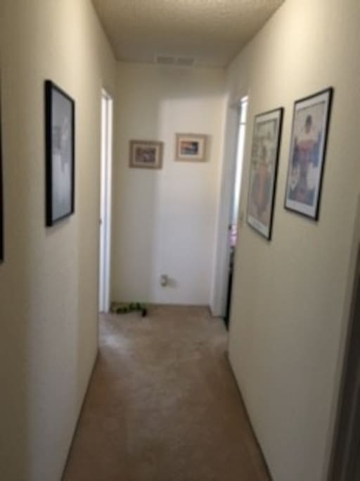 This photo shows the hallway between the two bedrooms,