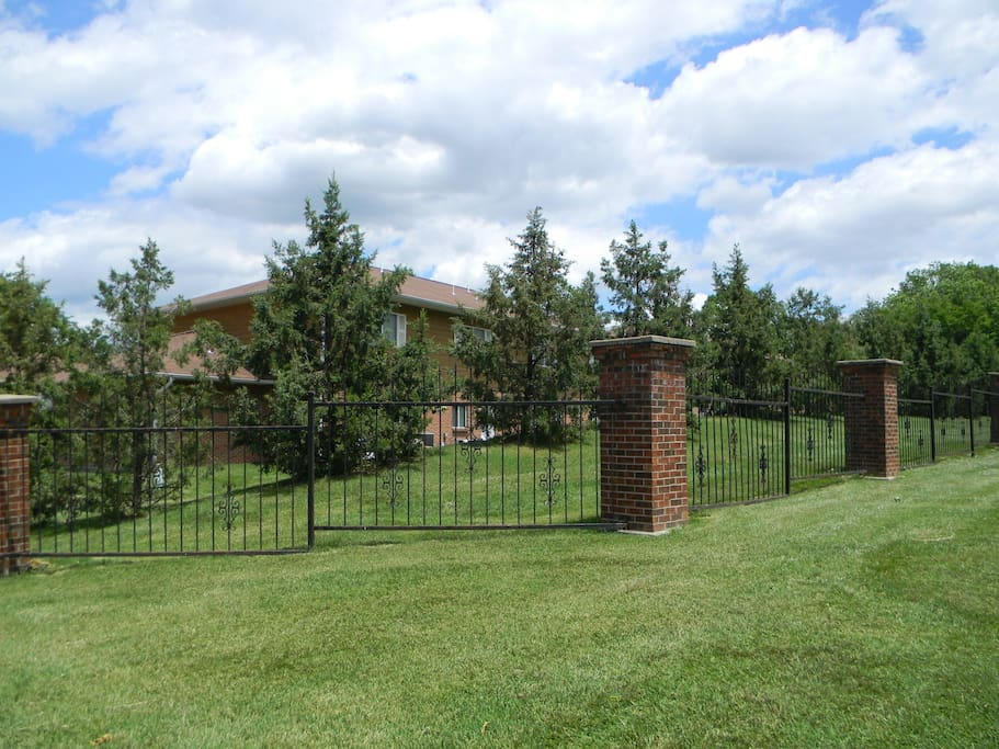 Large fenced in back yard is well maintained by grounds keeper