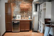 While there's no kitchen, you'll have a coffeemaker, coffee, and a mini fridge.