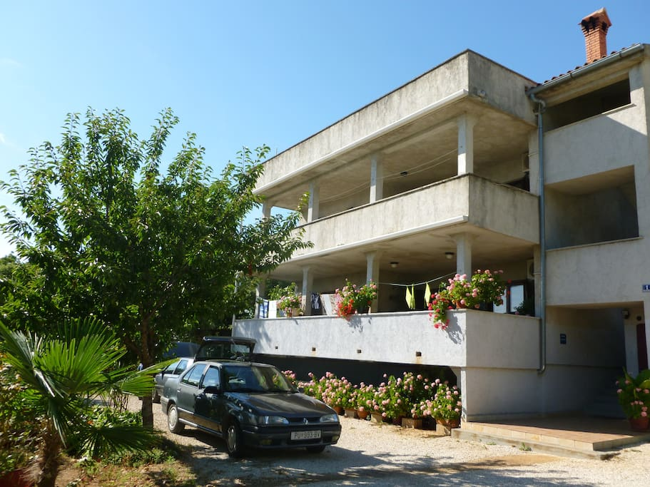 South facing large balconies, each 27 m 2. This is our family house. The holiday apartment is on the 1st floor. Big garden around and free parking in front of the house.