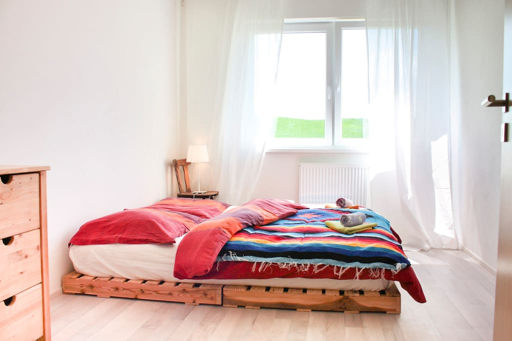 The master bedroom featuring large pallete bed with super comfortable futon to sleep on
