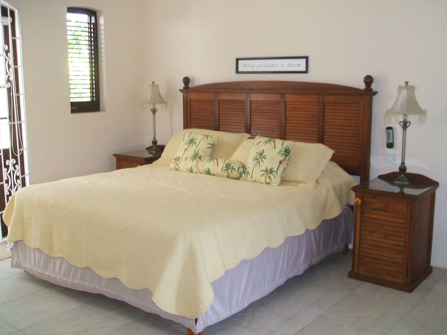 King Sized bed with gorgeous linens.