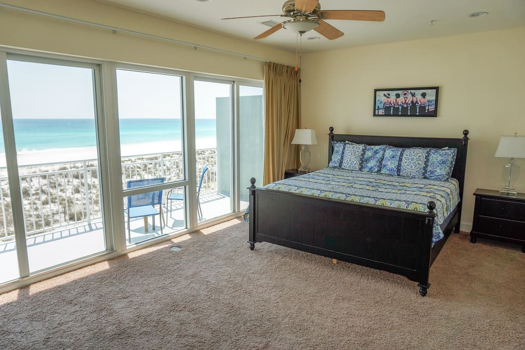 Master bedroom and balcony with view of sugar white sand beaches and emerald waters.