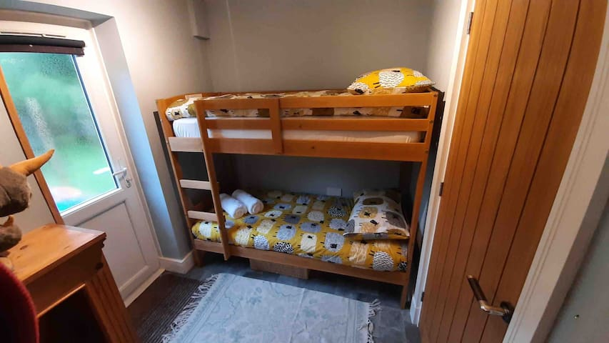 Bunk room, shorty bunk bed suitable for children or small adults, situated off the main bedroom.