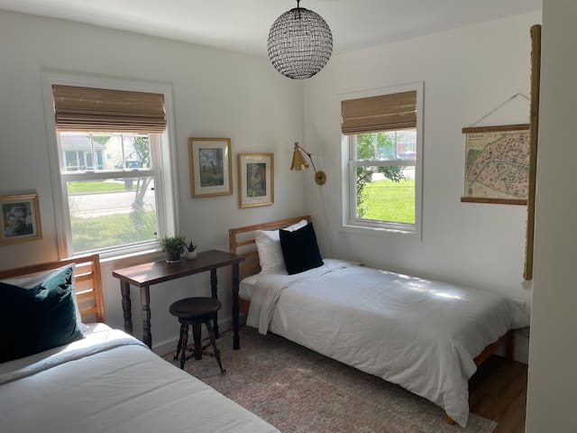 Front bedroom with 2 cozy twin beds and quaint work area.