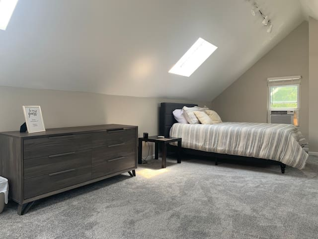 Queen memory foam bed is located in the attic area, bedroom two.