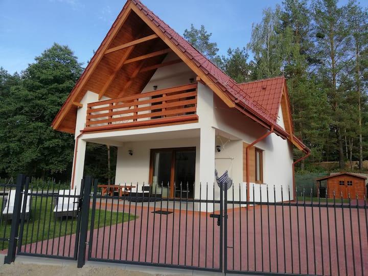 """Komfortowy dom """"Pod Żaglami"""" nad jeziorem Tajty"""