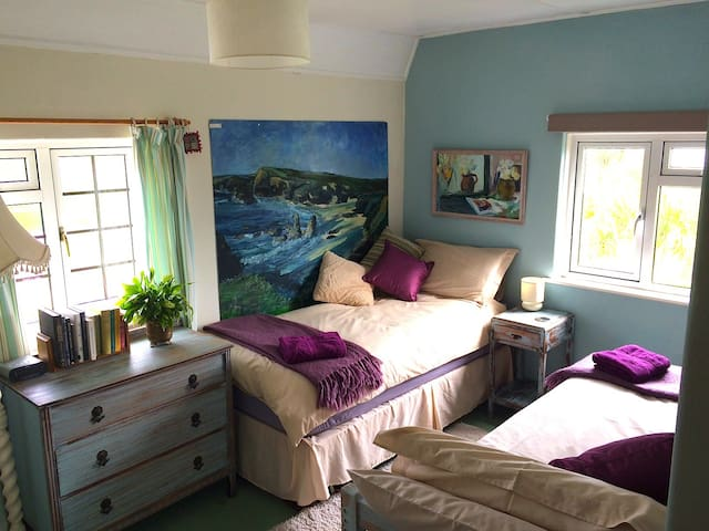 Neat and  comfortable; a bright and peaceful room, with twin beds for a gentle stop-over in a great location.
