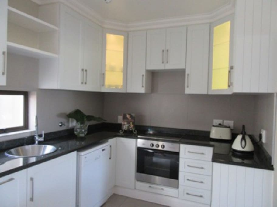 Kitchen with dishwasher, oven & microwave
