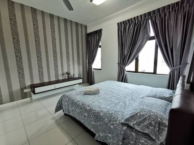 Master bedroom with King size bed and private toilet