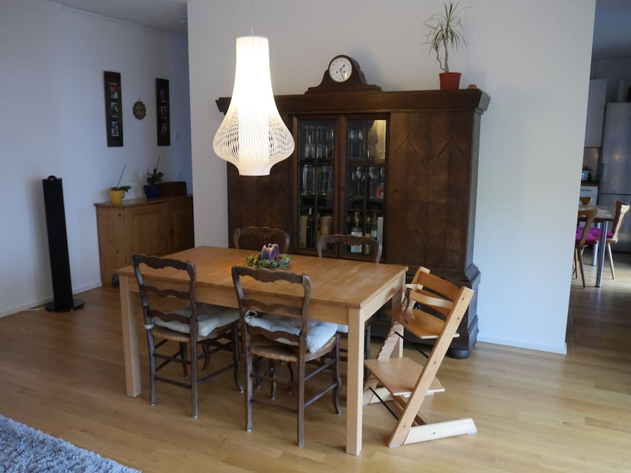 Dining area with antique glass cabinet and modern table that can be extended for additional guests