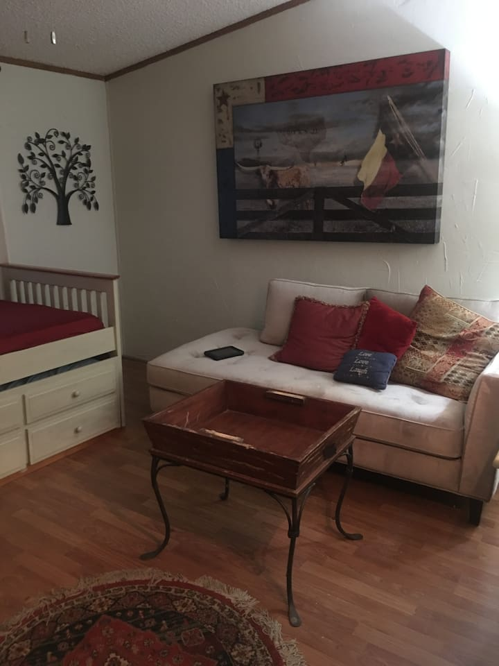 3rd bedroom with comfortable chase used to sleep