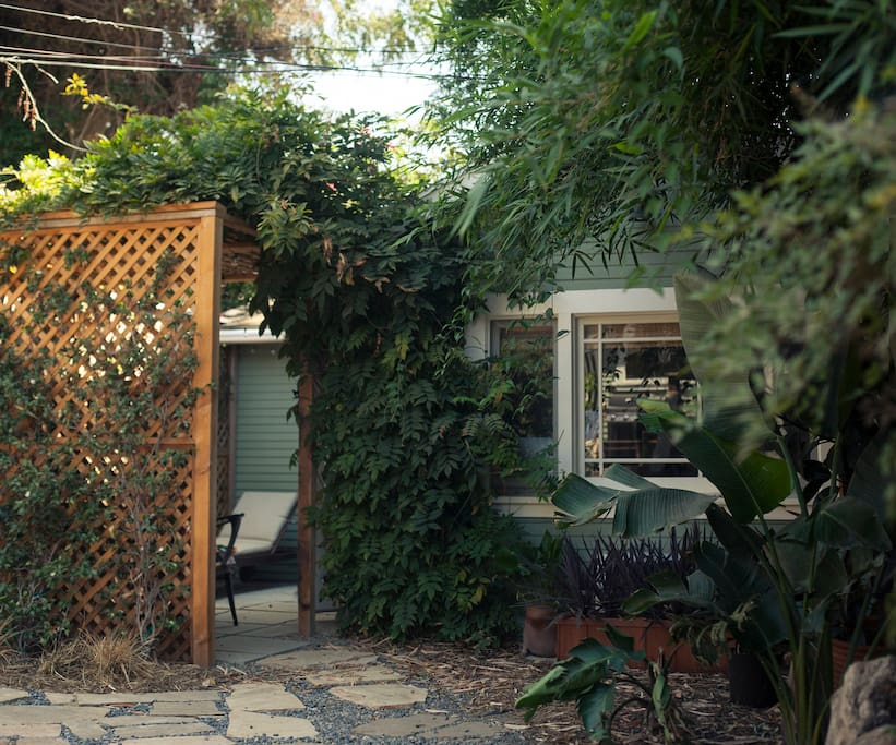 Enter under a wisteria-covered trellis onto your own private patio.