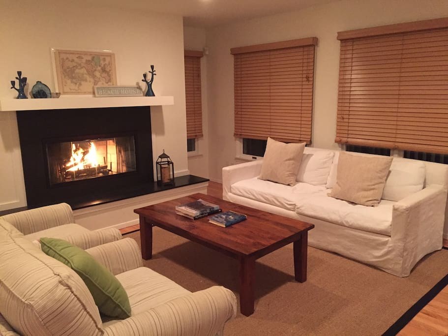Cozy fireplace in one of two living room spaces.