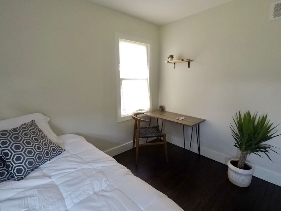 Newly renovated queen bed with a perfect small working desk
