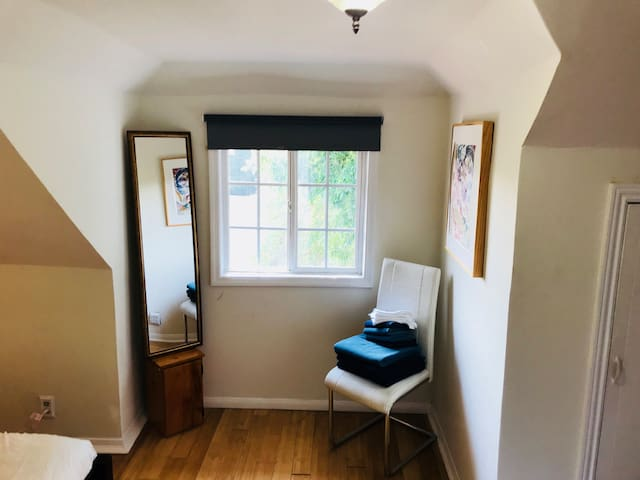 Great natural lighting in this upstairs room, we also provide you with a fresh supply of towels and the bedroom closet (door to the right) is perfect for storing your wardrobe.