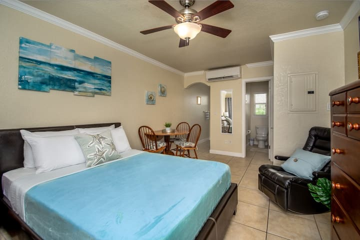 Comfortable space with dining table set, recliner, access to kitchen and bathroom