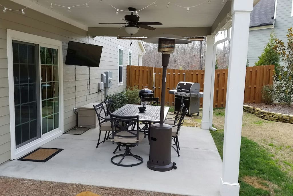 Covered patio with grills and tv