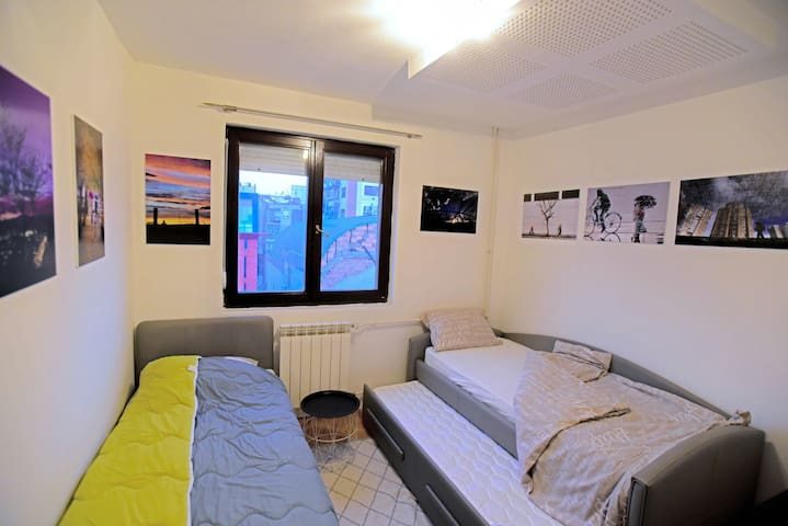 Bedroom with three separate beds
