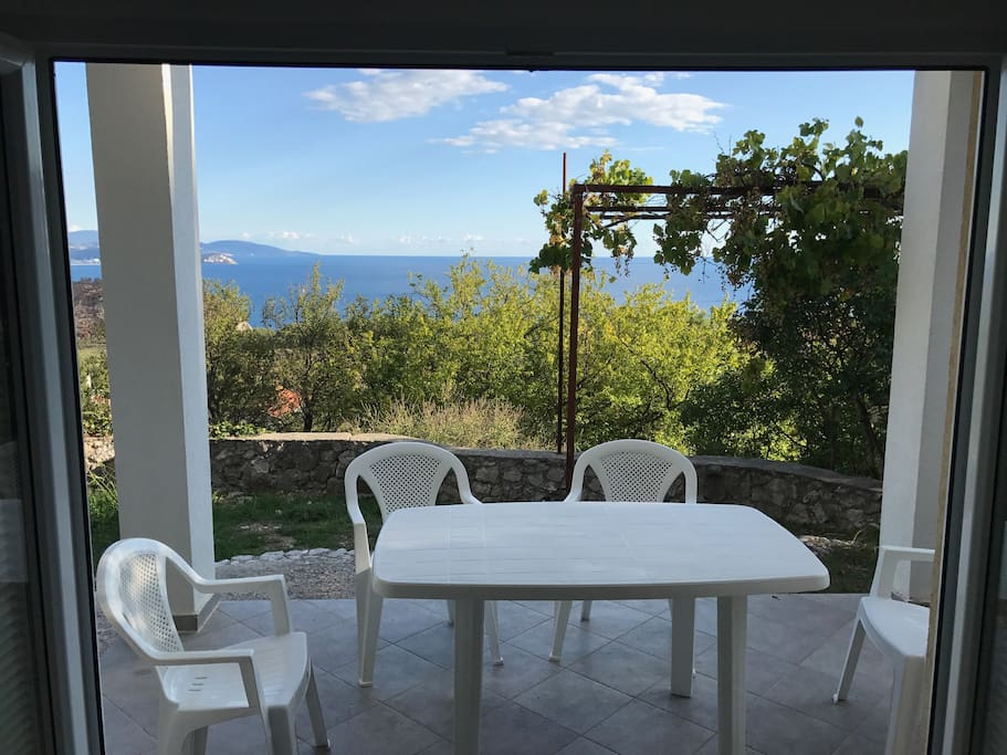 Double doors open onto the garden terrace with stunning views.  Ideal for al fresco dining.