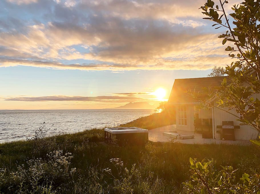 "We call the house ""Straumen Sea View"". This picture is taken July 10th 2018 at 11 pm."