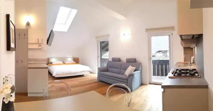 Attic apartment with panoramic loggia