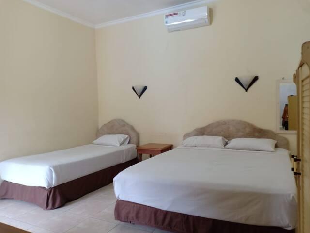 Triple Room with AC at Mutiara Batu