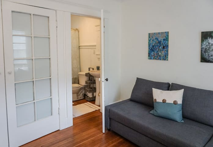 The glass panelled doors in the living area open to reveal a mini-office.